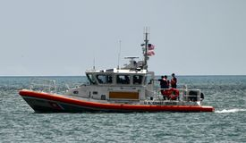 U.S. Coast Guard on Patrol. This is a Summer picture of a U.S. Coast Guard patrol boat on Lake Michigan located of Milwaukee, Wisconsin in Milwaukee County. This stock images