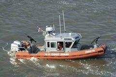 U.S. Coast Guard Patrols the Hudson River in New York City. A small U.S. Coast Guard boat patrols the Hudson River in New York City.    You can see a Coast Guard Royalty Free Stock Images