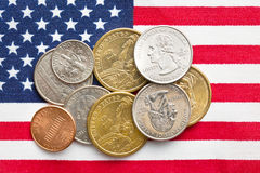 U.S. coins on American Flag Royalty Free Stock Image