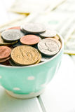 U.S. coins in ceramic bowl Royalty Free Stock Photography