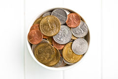 U.S. coins in ceramic bowl Royalty Free Stock Photos