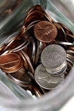 U.S. coins in a jar Royalty Free Stock Photo