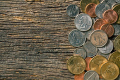 U.S. coins on old wooden background Royalty Free Stock Photos