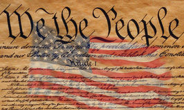 U.S. Constitution. This is the preamble to the U.S. Constitution that starts with the words, we the people. An American flag is digitally composited into the Royalty Free Stock Photography