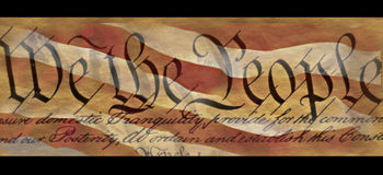 U.S. Constitution. This is the preamble to the U.S. Constitution that starts with the words showing We the People. It is set against a background of the red and Royalty Free Stock Photography