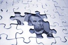 U.S. cuenta y rompecabezas de dólar cinco Foto de archivo libre de regalías