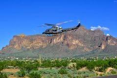 U.S. Customs Border Patrol helicopter Flying Low Casa Grande Arizona. 
