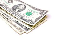 U.S. dólares em um fundo branco Fotos de Stock
