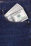 U.S. dólares no bolso das calças de brim Imagem de Stock Royalty Free