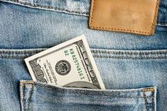 U.S. dólares no bolso das calças de brim Fotos de Stock Royalty Free