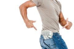 U.S. dólares no bolso traseiro das calças de brim Fotografia de Stock