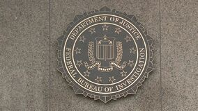 U.S. Department of Justice/Federal Bureau of Investigation Sign in Washington, D.C. stock footage