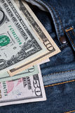 U.S. Dollar. Notes in a blue jeans Stock Photography
