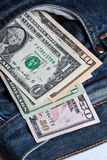 U.S. Dollar. Notes in a blue jeans Stock Images
