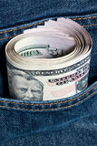 U.S. Dollar. Notes in a blue jeans Stock Photo