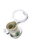 U.s. dollar bills with handcuffs Royalty Free Stock Photography
