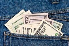 U.S. dollari nella casella dei jeans Immagini Stock Libere da Diritti