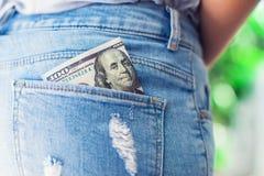 U S Dollari nella tasca posteriore dei jeans Fotografia Stock Libera da Diritti