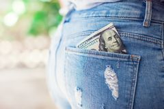 U.S. dollars in the back jeans pocket royalty free stock photos