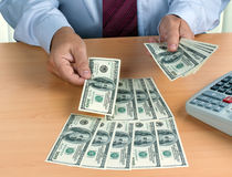 U.S. dollars banknotes are counted Royalty Free Stock Photography