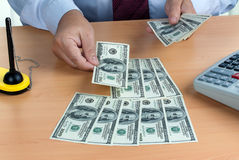 U.S. dollars banknotes are counted Stock Photo