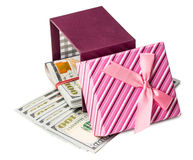 U.S. dollars banknotes laying in red bow decorated gift box. Stock Photography