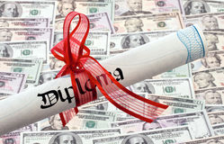 U.S. dollars bills and Diploma Stock Photography