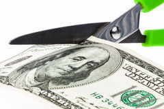 U.S. dollars bills and scissors Stock Images