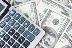 U. S. Dollars and calculator. Royalty Free Stock Photos