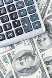 U. S. Dollars and calculator. Stock Photography