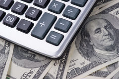 U. S. Dollars and calculator. Stock Images