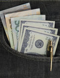 U.S. dollars and China yuan in the back jeans pocket Royalty Free Stock Images