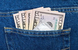 U.S. dollars and condom in the jeans pocket Royalty Free Stock Image