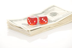 U.S. dollars and dice isolated on Stock Photo