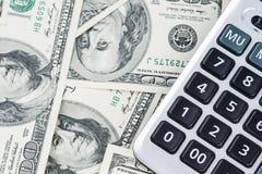 U S Dollars et calculatrice Photo stock