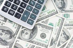 U S Dollars et calculatrice Images stock