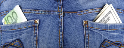 U.S. dollars and EURO in the back jeans pocket. S Stock Images