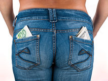 U.S. dollars and EURO in the back jeans pocket. S Royalty Free Stock Photos