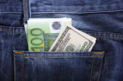 U.S. dollars and EURO in the back jeans pocket. S Royalty Free Stock Images