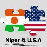 U.S.A. e bandiere del Niger nel puzzle Fotografie Stock Libere da Diritti