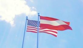 U.S.A. e bandiere dell'Austria che ondeggiano contro il cielo blu Immagine Stock Libera da Diritti