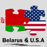 U.S.A. e bandiere della Bielorussia nel puzzle Fotografie Stock
