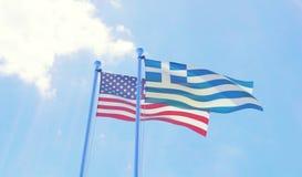 U.S.A. e bandiere della Grecia che ondeggiano contro il cielo blu Immagini Stock