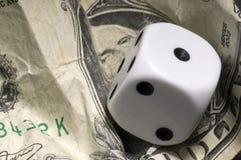 Is u.s economy struggling ?. White dices on u.s. dollar Stock Image