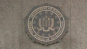 U S El Ministerio de Justicia/la Oficina Federal de Investigación firma adentro Washington, D C metrajes