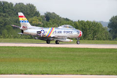 U.S. F-86 Sabre Fighter Jet. An American Saber Fighter Jet taking off at an airshow Stock Images