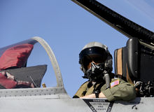 U.S. Fighter Pilot in a Fighter Jet. United States Fighter Pilot in full gear sitting in a fighter jet Royalty Free Stock Photo