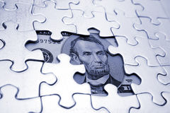 U.S. five dollar bill and puzzle Royalty Free Stock Photo