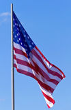 U.S. flag. On a background of blue sky Stock Image