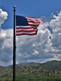 United States Flag. The U.S. flag flies above the visitor center at Garden on the Gods in Colorado stock photos